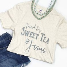 """This is a super-soft unisex tee with our """"Raised on Sweet Tea & Jesus"""" design. Fit: Unisex and runs true to size. *Tri-Oatmeal with grey/silver design. Size Bust/Chest Inches XS 30-32 Small 34-36 Medi"""