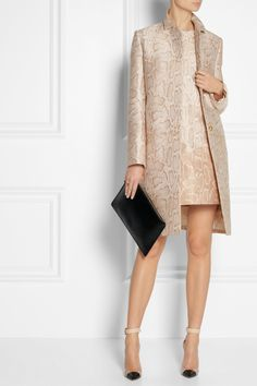 STELLA MCCARTNEY Kevin python-jacquard coat $1,865  Animal motifs are the new neutrals. Expertly tailored for a clean-lined silhouette, Stella McCartney's python-jacquard coat will work from day to night. For a polished take, layer it over the matching dress, or break up the pattern with cream separates.