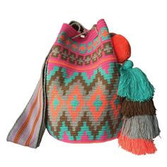 www.lombiaandco.com The colors of this mochila Wayuu was inspired by the vivid colors that surround region of La Guajira. Sand, sea, desert, sun and a clear sky are constants in the landscape. Geometric figures are a signature of these mochila bags. #wayuubag