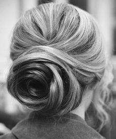 One of the most simple, yet beautiful styles... the bun resembles a rose, and her highlights only add more dimension to the style. This is great for women whose hair does not hold a curl easily!