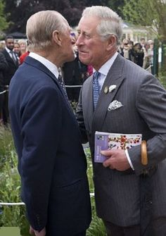 2013: The affection between Prince Charles, Prince of Wales (R) and his father Prince Phillip, Duke of Edinburgh is obvious as they share an air kiss in the Forget-Me-Not Garden