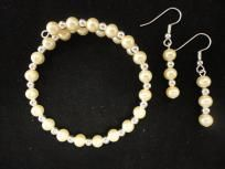 Oyster white pearl and silver spacer beads..memory wire bracelet and matching earrings