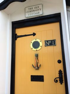 Inspiration: The Tranquil Pastels of a Seaside Town - yellow nautical door - The Chromologist