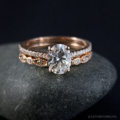 Our intricate and unique wedding band paired with an oval solitaire engagement ring will sweep any bride-to-be off her feet!