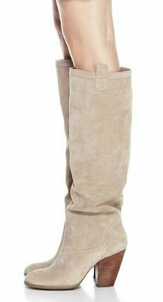 Beige coloured knee length boots