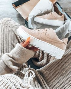 Nike Air Force 1 Sage Shoes – Beige 2019 Nike Air Force 1 Sage sneakers in a beige / suede / nude colour. Seriously cool shoes held by girl with long fingernails in a cosy tracksuit outfit taking the Nike trainers out of the box. Very fresh. Nike Air Force Beige, Nike Shoes Air Force, Nike Air Force Ones, Nike Air Force 1 Outfit, Beige Sneakers, Beige Shoes, Sneakers Nike, Nike Trainers, Platform Sneakers