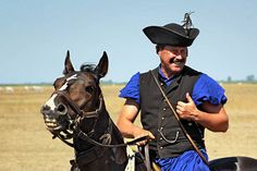 They say people look like their pets. Does this traditional herdsman in the Hungarian puszta at Hortobagy National Park resemble his trusty steed?