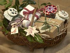 DIY Sweet, Homemade Christmas Basket - Give a variety of sweet, homemade produce as a gift: package up chocolate brownies, a ginger cake, nougat treats and fruit jam in airtight tins, pretty boxes and decorated jars, and arrange them in a decorated, medium-sized basket. Add greenery, twine and ribbon for an extra holiday touch.