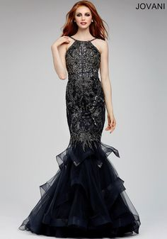 Elegant sleeveless mermaid dress features a beaded bodice and tiered tulle skirt