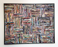 Frame full of bent magazines. A cool piece of art.