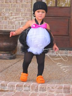 penguin tutu, with her curly hair showing though, too cute!