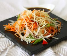 green papaya salad~ My most favorite sald in the world...literally. Dang, now I am salivating, guess now I know what I NEED to have for dinner ;)