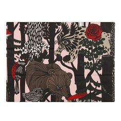 Marimekko's Veljekset (Finnish for brothers) placemat features an enchanting pattern that depicts bears, bobcats, squirrels, woodpeckers and owls among dark trees. Inspired by Finnish folklore, Maija Louekari designed the forest motif to celebrate the centennial of Finland's independence.