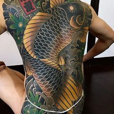 Japanese back tattoo by @hori_tora. #japaneseink #japanesetattoo #irezumi #tebori #colortattoo #colorfultattoo #cooltattoo #largetattoo #backtattoo #fishtattoo #koitattoo #scripttattoo #wavetattoo #naturetattoo