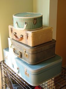 i really like the idea of vintage suitcases as decor/shelves/holders for cards or something- maybe we can find one at a thrift shop?