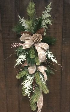 Not the same colored ribbon, but an idea for the garage door lights Hanging Christmas Lights, Christmas Door Wreaths, Christmas Swags, Christmas Door Decorations, Outdoor Christmas, Holiday Wreaths, Rustic Christmas, Christmas Holidays, Christmas Crafts