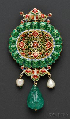 Fine Carved Emerald and Diamond Pendant, India, set with a carved emerald tablet depicting flowers, foliage, and Islamic script, measuring approx. 31.00 x 21.44 mm, framed by rose-cut diamonds, and suspending a carved emerald drop measuring approx. 29.00 x 15.90 mm, flanked by pearls, high-karat gold mount, the reverse pierced and finely enameled, 3 7/8 x 2 in.