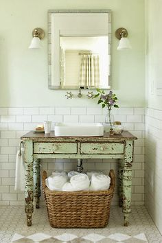 2012 Idea House: Farmhouse Restoration: Vintage Bathroom: Give a new room instant age. A perfectly worn painted table breaks up the sea of white tile and carries on the farmhouse look. Keep tile classic. White subway-style tiles by Daltile pai Rustic Bathrooms, Modern Bathroom, Guest Bathrooms, Vintage Bathrooms, Bathroom Interior, Modern Sink, Downstairs Bathroom, Simple Bathroom, Master Bathroom