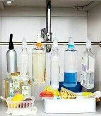 Use bathroom curtain rod to hang your spray bottles ..makes room n no spills DIY