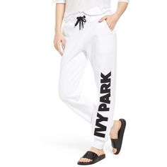 Women's Ivy Park Chenille Logo Jogger Pants ($82) ❤ liked on Polyvore featuring activewear, activewear pants, white, jogger sweatpants, logo sportswear, white sweat pants, white sweatpants and sweat pants