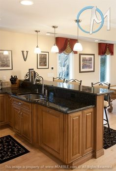 Butterfly Granite in Kitchen photo gallery. Probably Verde Butterfly granite. Dark granite countertops with oak cabinets.