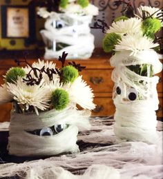 A bunch of easy mummy themed ideas for Halloween - These Mummy Vases are super cute and there are tons of mummy food ideas.