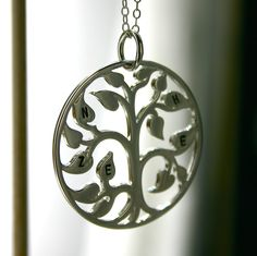 The original Personalized pendant family tree necklace - Stamped initial family tree of life - hand stamped jewelry. $52.50, via Etsy.