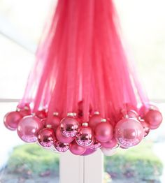 Setting the holiday table with hanging chandelier made of fancy ribbon and decorative baubles ~