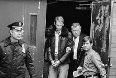 Bernhard Goetz, escorted by detectives, leaves New York Police headquarters, Jan. 3, 1984, after his return from Concord, N.H., where he turned himself in and admitted to shooting four youths on a New York subway train in December. [AP Photo]
