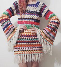 Striped rainbow crochet bell sleeve mini dress with fringe edges, handmade one of a kind • Available now 🌈 #cruxandcrow #handmade #bellsleevedress #crochetdress #70sstyle #bohostyle #hippie #rainbow #70s #etsyau #vintageshop