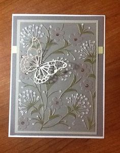 by Judy Shears, Florida, USA.  Another Dandelion embossing folder, this one by Darice. Did some coloring with distress inks, used the Wink of Stella glitter pen on the leaves and posies (doesn't show up in the photo, but adds a subtle shine), some Stickles on the dandelions, added some bling and the Vivienne Butterfly by Memory Box.