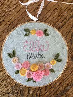 "FELT FLOWERS with NAME- Personalized Girl's Name Embroidery 8"" Hoop Art made with Felt Flowers and Patterned Fabric by Miss Tweedle by MissTweedleCrafts on Etsy https://www.etsy.com/listing/187877342/felt-flowers-with-name-personalized"