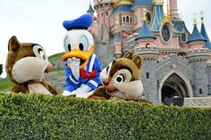 Chip, Dale, and Donald Duck by Sleeping Beauty's Castle in Paris Disneyland