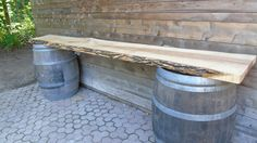 Live edge wood tables with wine barrels available for rent at Kortright!! Perfect for your guest book or gift tables
