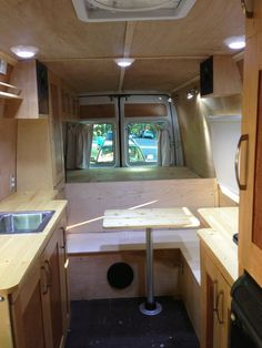 We may want to have cabinets on both sides. Looks more open if there is only a full height cabinet on driver side? Love natural wood.