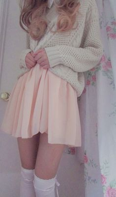 Knitted, grey sweat over a light pink skirt with white thigh highs. Love.
