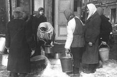 Women collect water on Nevsky Prospekt in the besieged Leningrad. Spring 1942