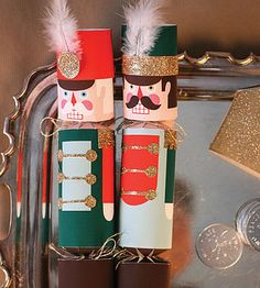 Diy Nutcracker Cracker crackers. Love the gold and feathers.