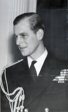 A portrait of the handsome Duke of Edinburgh in 1948 wearing his naval uniform.