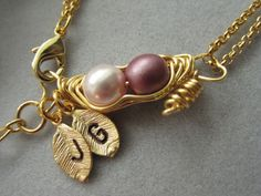 Two peas in a pod gold bracelet via Etsy.--I love this!