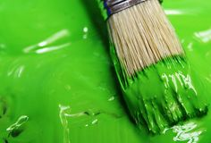 green paint and brush