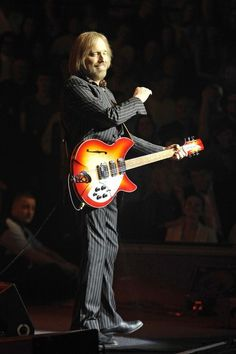 Tom Petty and the Heartbreakers perform live in concert at Royal Albert Hall in Kensington, London. The classic rock band were performing in their first British gigs in 13 years. Classic Rock Bands, Captain Jack Sparrow, Royal Albert Hall, Tom Petty, The Twenties, Toms, Kensington London, Concert, Traveling