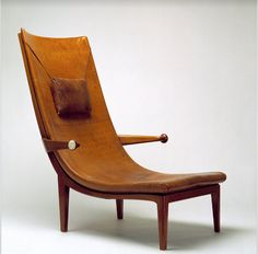 Armchair made for the 'Exposition des Arts Décoratifs et Industriels Modernes' in 1925. Designed by architect Erik Gunnar Asplund /  Mahogany and leather. The armrests are finished with ivory medallions.