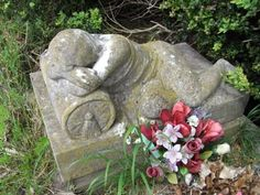 A Somerset Grave is topped by a weeping figure. It's mourning sorrow is there for all to see.