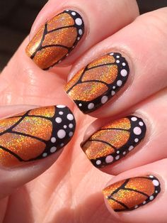 .holographic butterfly nails