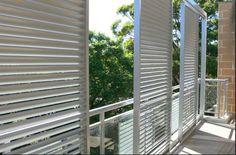 full height sliding horizontal louvres and glass balustrade