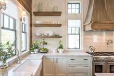 Love the open shelves in this gorgeous white kitchen - take the full home tour eclecticallyvintage.com