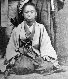 Samurai wearing a holster with a Western type pistol.