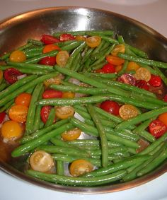 sauteed green beans with tomatoes, garlic soy and oyster. Pork if you want meat in it.