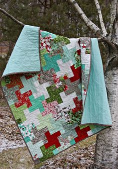 Christmas Cogs Quilt by Amy Friend for Basic Grey- Blitzen fabrics used. I like the quilt- the tutorial could be a little more clear for determining how much fabric you need, but a nice quilt, nonetheless. I'm looking for something to make with my 2 Blitzen Charm Packs.